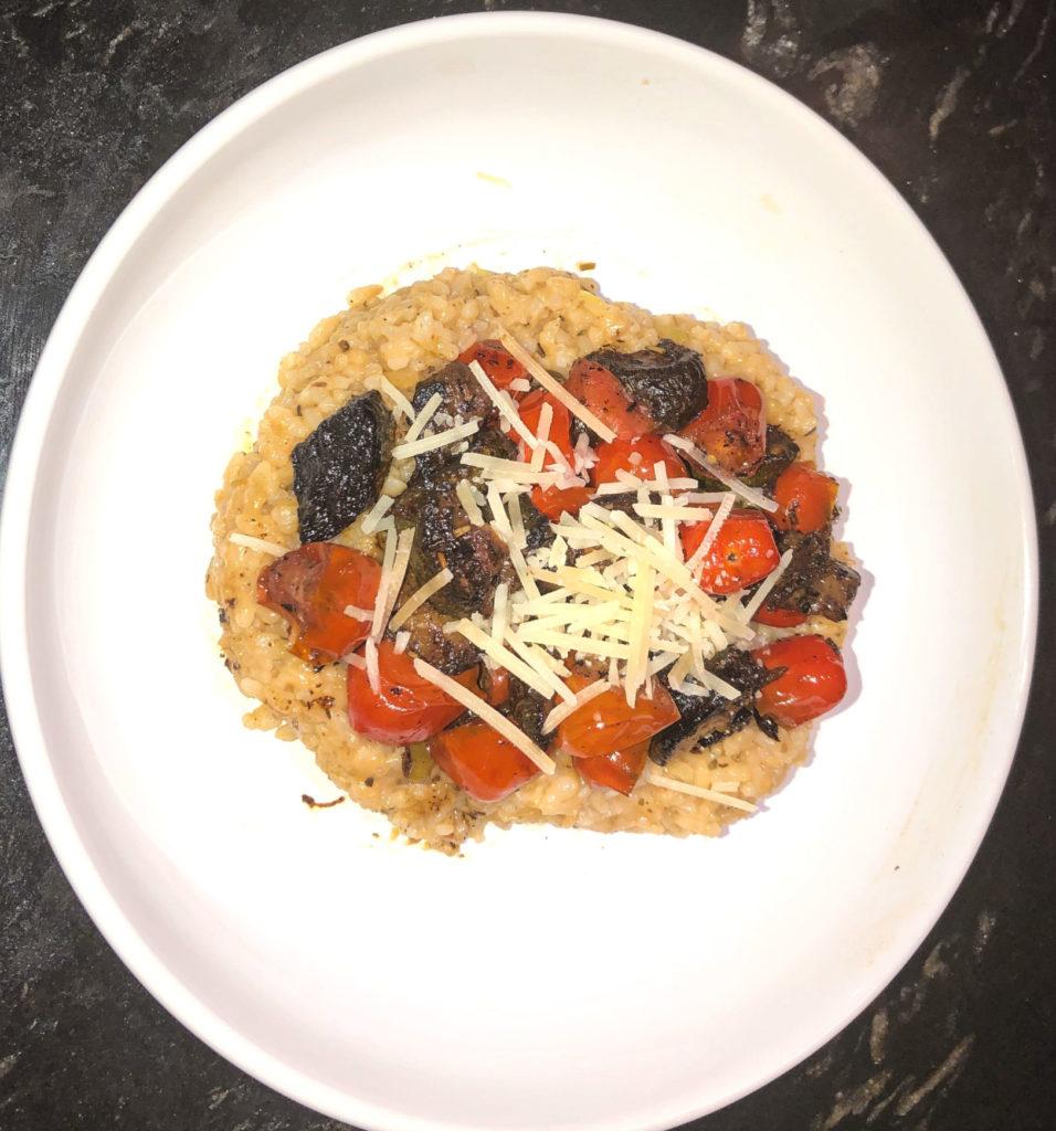white plate with tomato zucchini risotto